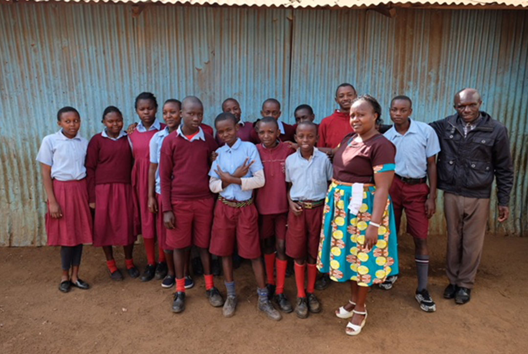 Kenya : September 2018 : Head teacher Alice with teacher Thomas and some of our older students