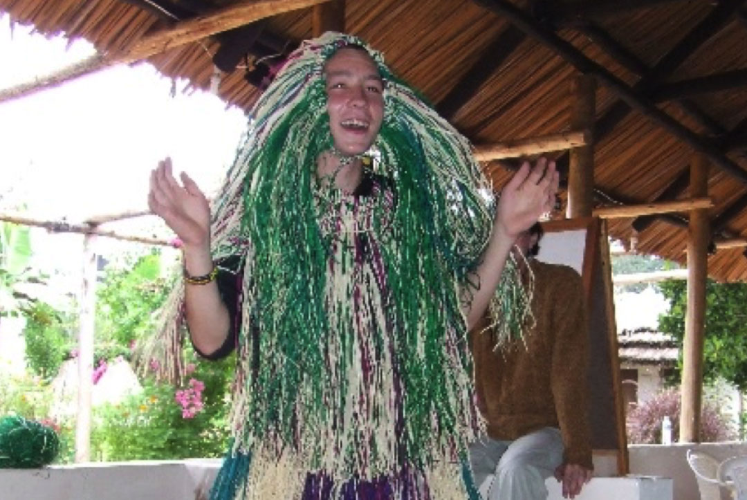 Uganda 2008 : Enjoying some down time being shown how to make some traditional grass skirts