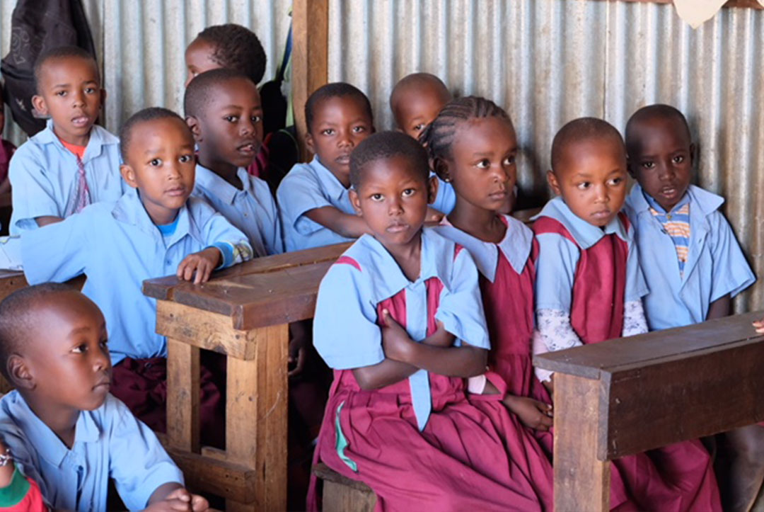 Kenya : September 2018 : Four children to a bench, we really need more space!