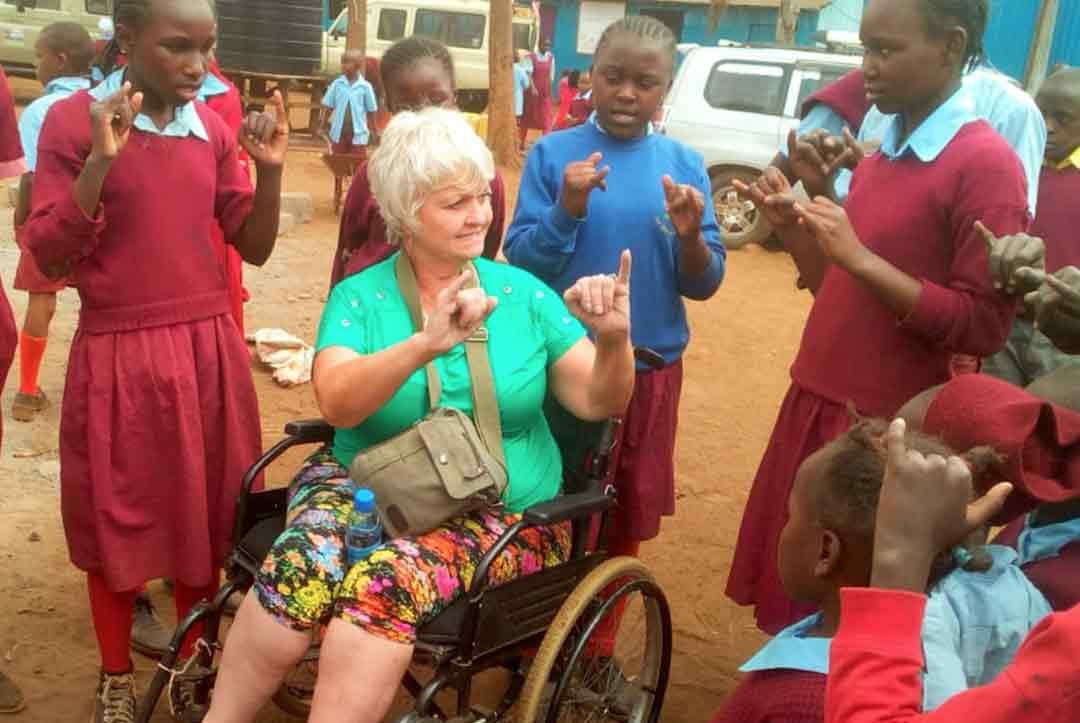 2019-Kenya-06-One-of-our-volunteers-Dee-teaching-the-language